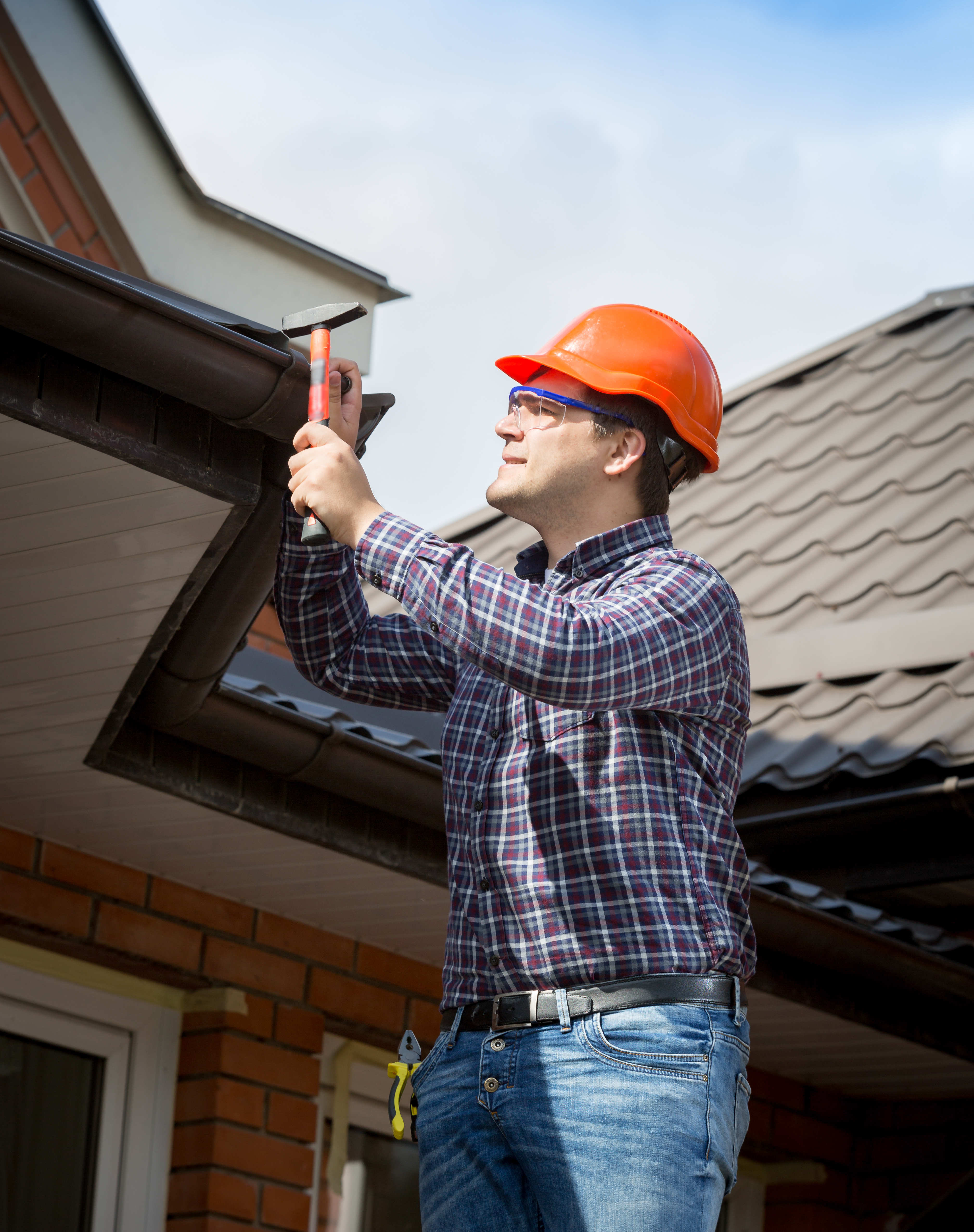 repairman-repairing-inspecting-house-for-roof-replacement-content-image.
